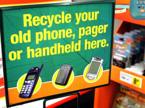 Recycling programs, like this one for small electronic devices at Staples, encourage shoppers to empty their junk drawers of old phones and pagers.