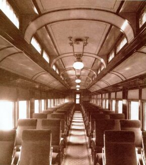 This unidentified railroad day coach of 1913 was stylish and up-to-date with reclining walkover seats, carpeting, separate waterclosets, and gas lighting.