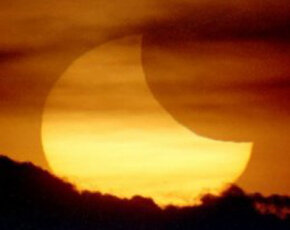 The Earth and moon are tiny compared to the sun, but the moon's shadow can completely cover the sun during an eclipse.