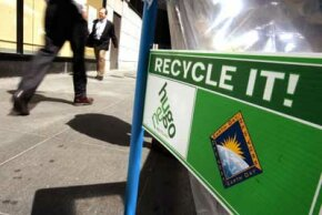 Recycling bins are placed on the street to celebrate the 35th anniversary of Earth Day in New York City.