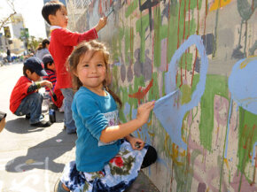 Audrey Jackson celebrates Earth Day 2008 by painting a mural at the Wilshire Center in Los Angeles.