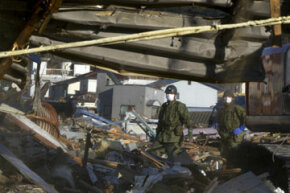 Japanese military search a collapsed building for bodies in March 2011, two weeks after the 9-magnitude earthquake.