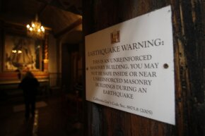This earthquake warning sign was posted at the entrance to the basilica at the Carmel Mission in Carmel, Calif. The basilica started getting a seismic retrofit in 2012.