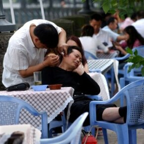 A Chinese man has his earwax picked by a chiropodist at an outdoor tea house in Chengdu, China. Contrary to what many people believe, there's no need to remove earwax unless it's impacted.