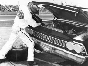 Smokey Yunick, pictured here at the 1967 Daytona 500, really knew his way around under the hood of a car.
