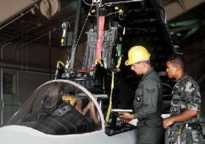 An ejection seat being removed from an F-15C Eagle