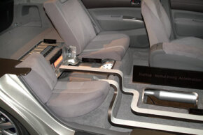 This cutaway car shows the location of the battery pack in a 2004 Toyota Prius, right behind the rear seat.