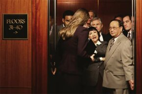 If the elevator is already full, don't try to squeeze on. Be polite and wait for the next one.