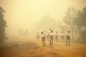 In 1997, Indonesian children walked through smoke as wildfires brought on by El Nino raged across the country.