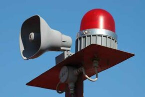 An air raid siren can be heard for miles
