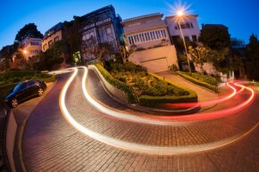 San Francisco's Lombard Street at dusk is beautiful (and crooked and steep). It could also be rather problematic for cars with less than optimal power.