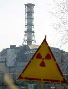 A sign warns of nuclear radiation at the site of the Chernobyl nuclear disaster.