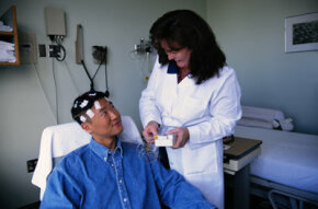A patient prepares for an EEG.