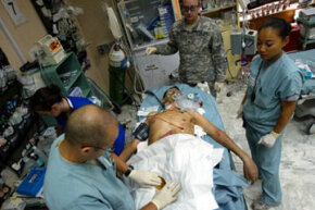Combat surgery has come a long way since the unmedicated amputations of the Civil War. Here, U.S. Army Dr. Robert Mazur and his staff work on an Iraqi soldier with a bullet lodged in his heart at the 10th Combat Support Hospital in Baghdad, Iraq.