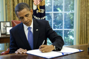 President Barack Obama signs an extension of unemployment benefits in July 2010.