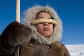 Inuits wear warm clothing like coats made of animal hides and fur to generate heat.