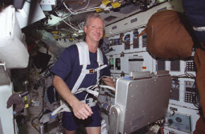 Astronaut Steven A. Hawley, mission specialist, runs on a treadmill on the middeck of the Space Shuttle Columbia. The exercise helped to evaluate the Treadmill Vibration Isolation System (TVIS) for International Space Station (ISS).