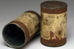 These two tin cans containing food date from the Boer War (1899-1902). Canned food was developed in the 1860s.
