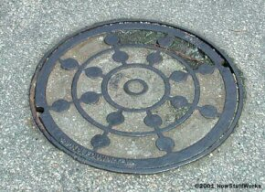 An 85-pound manhole cover can become a missile when blasted out of the ground.