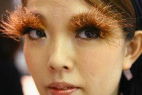 A woman models false eyelashes in Shu Uemura's eyelash bar. See our make up tips pictures.