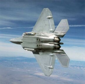 This F/A-22 is carrying two AIM-9M Sidewinder missiles in its side weapons bays.