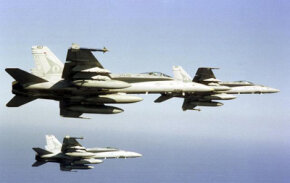 F/A-18s bank while in formation. See more military jets pictures.