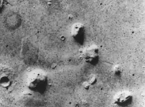 The dim image captured by Voyager 1 launched many conspiracy theories. See more Mars pictures.