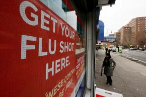 A sign advertises flu shots at a Manhattan pharmacy during the 2013 flu epidemic. Despite media reports to the contrary, flu shots were readily available.