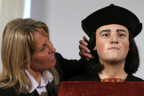 Philippa Langley, originator of the Looking for Richard project, poses next to a facial reconstruction of King Richard III at a London news conference. The bones of the last English monarch to die in battle were found under a car park in 2012.