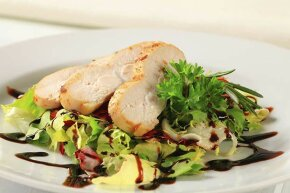 Though it's been prettified atop this salad, the boneless, skinless chicken breast usually tastes bland.