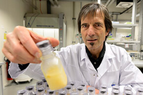 Martial Saugy, head of the Swiss Laboratory for Doping Analyses (LAD) of the Centre Hospitalier Universitaire Vaudois poses with an anti-doping sample of urine in his laboratory.