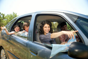 Want to take a cheaper family vacation? Try driving your car, packing your own food or camping to save money.