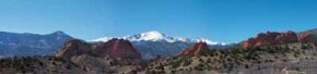The snow-capped majesty of Pikes Peak looms over the red rock formations of Garden of Gods in Colorado Springs.