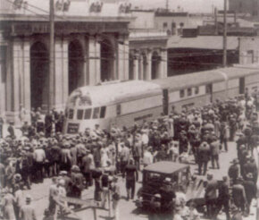 Following Zephyr's record-shattering speed run from Chicago to Denver, the train went on a national promotional tour. Arriving in Oakland, California, the train is mobbed by curiosity seekers.