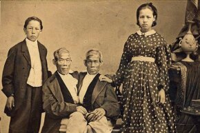 "Chang and Eng Bunker, the namesake of the phrase ""Siamese twins,"" pose with their children."