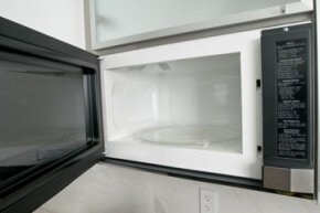 "Microwave ovens are one common product that use a Faraday cage. Instead of keeping microwaves out, they force them into a small cooking chamber that ""nukes"" your food."