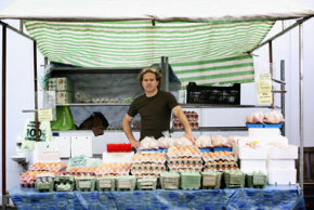 A stall at the Marylebone Farmers' Market sells farm-fresh eggs.