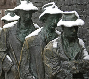 The sorrowful faces of the life-size statues are a powerful expression of the times, showing the inactivity and troubles of everyday citizens during the Great Depression.