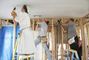 Volunteers from the Mennonite Disaster Service help to rebuild housing damaged by hurricanes in Florida.