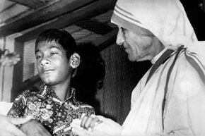 Mother Teresa comforts the Indian wolf boy Shamdeo at her charity home 'Prem Niwas' in Lucknow in 1980.