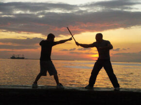 Anderson and Smith spar with kali swords in the Philippines. See more extreme sports pictures.