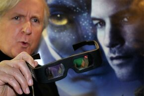 Director James Cameron displays a pair of 3-D glasses prior to a showing of his movie 'Avatar' at the World Economic Forum annual meeting in Davos, Switzerland in 2010.