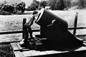 Buster Keaton peers inside what appears to be a cannon in 'The General.'