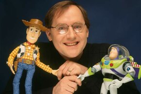 'Toy Story' director John Lasseter is shown with two of his characters from the film, Woody (left) and Buzz Lightyear in 1996.