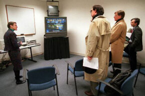 Microsoft Program Manager Suze Woolf demonstrates the potential for HDTV in a 1995 meeting. See more HDTV pictures.