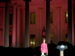 On Oct. 7, 2008, Laura Bush pushes a button to bathe the White House in pink light in honor of Breast Cancer Awareness Month.