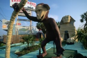 Mini-golf includes all sorts of fun gags and obstacles, like this wacky monkey.