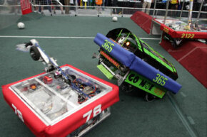 Machines clash at the FIRST Robotics Competition.