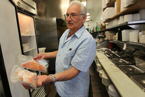 Red snapper is the most mislabeled fish.  Here, Nobel Garoa, owner of El Oriental de Cuba admits he used to substitute ocean perch for red snapper, but no longer does that. He shows red snapper on the right, and ocean perch on the left.
