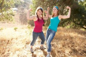 The girl on the right is rolling her pant legs up for her canyon hike -- but when she celebrates her accomplishment with a night on the town, she'll want to switch to her flared, dark jeans.